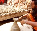 Potter busy making earthen lamps