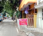 BBMP puts COVID-19 warning banner at Okalipuram