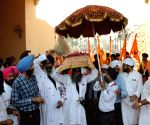 Attari (Punjab): Sikh devotees cross Attari-Wagah border to reach Nankana Sahib in Pakistan
