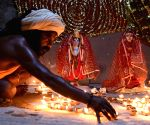 People light earthen lamps, perform rituals on banks of Ganga to mark Ram Temple 'Bhumi Pujan' in Ayodhya