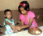 A sister ties rakhi on the wrist of his brother