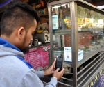 Tea stall owner display a sign accepting mobile payment