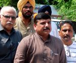 Sanjay Singh appears before a court in defamation case