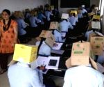 Free Photo: Karnataka students made to wear cartons to avoid copying