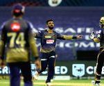 File Photo: Varun Chakaravarthy of Kolkata Knight Riders celebrates the wicket of David Warner captain of Sunrisers Hyderabad