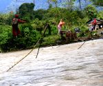 INDONESIA ACEH DAILY LIFE CROSSING RIVER