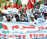 Activists of Social Democratic Party of India take out a protest rally on 21st anniversary of Babri Mosque demolition