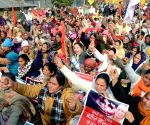 Activists of various organisations take part in a demonstration held in support of farmers