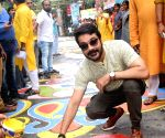Durga Puja preparations - Prosenjit Chatterjee participates in painting Alpona street