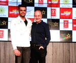 """Actors Anupam Kher and Manish Paul at the music launch of their upcoming film """"Baa Baa Black Sheep"""" in Mumbai on March 1, 2018."""