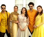 "Film ""Kalank"" star cast during photo shoot and media interactions"