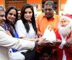Actress Haardika Shetty distributes cakes to orphans ahead of Christmas