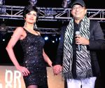 Actress Mandira Bedi during Autumn/Winter 2013 fashion show