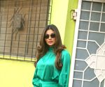 Photos: Mouni Roy is a vision of adorable satiny green as she spends time with her young fans at shelter home