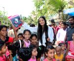 Poonam Pandey distribute raincoats to street children