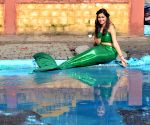 Sonu Gowda poses as a mermaid in front of a pothole