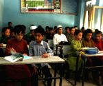 Afghanistan's secondary, high schools reopen for boys