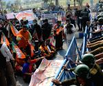 Members of BJP teachers cell took part in a protest rally against the State Government