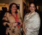 Aishwarya Rai Bachcham's mother Vrinda Rai with a guest at the Harmony Art show hosted by Tina Ambani at Chhatrapati Shivaji Maharaj Vastu Sangrahalaya's Coomaraswamy Hall in Mumbai Friday. Rajya Sabha MP Jaya Bachchan inaugurated the show.
