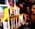Indo-Pak international border: Akhil Bharatiya Human Rights Organisation members hold a candlelight vigil to pay tribute to Nelson Mandela