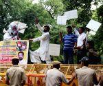 supporters of Narsingh Yadav demonstrate