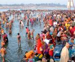 Thousands take holy dip a