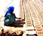 May Day - labour busy working at a brick kiln