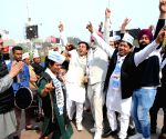 Poll victory celebrations at AAP office