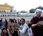 Sikh devotees participate in 'kar sewa