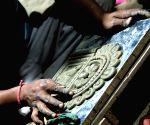 Artist busy working  at a Delhi workshop ahead of Durga Puja