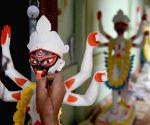 : Kolkata :An artist giving finishing touch on an Idol of Goddess Kali at Kumartuli workshop ahead of Kali Puja festival