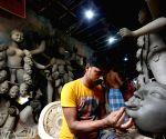 : Kolkata : An artist making an Idol of Goddess Kali at Kumartuli workshop ahead of Kali Puja festival in Kolkata