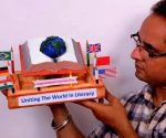 Artist showcases his creation on International Literacy Day