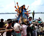 Durga idol being transported by boat