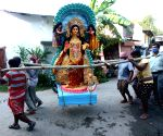 People take home idols of Goddess Laxmi on the eve of Laxmi Puja from Kumartuli workshop