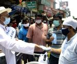 Kolkata :An old man distributed masks and sanitizers to people during the increasing numbers of COVID 19