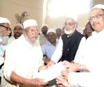 Syed Mohammed Ahmadullah distributing Haj forms to pilgrims