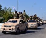 Syrian army enters Kurdish-held city, air base