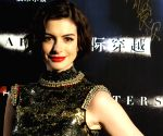 Anne Hathaway: My kids love to wrestle