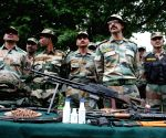 Arms and ammunitions recovered by the Indian Army near LOC being displayed