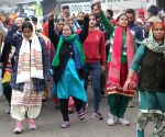 Women farmers sport mehendi with 'protest' slogan at Ghazipur