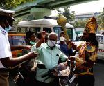 As a part of the Road Safety awareness YamadharmaRaja stops two wheelers with people not wearing their helmets