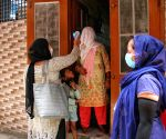 ASHA workers conduct door-to-door screening for COVID-19