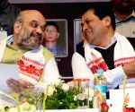 Sarbananda Sonowal with BJP chief Amit Shah