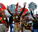 Soldiers celebrate India's victory over Pakistan in a World Cup 2015 match