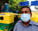 Free Photo: New Delhi: Auto drivers standing outside Kovid Hospital, helping to leave the patient to their destination