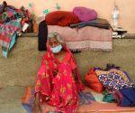 Baadama Devi Wife of Baba ka dhaba Kanta Prasad sitting outside Safdarjung Hospital emergency after Baba admitted on ICU ward last night, He was attempt to suicide in New Delhi