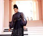 Free Photo: Sanya sets holiday goals with Qatar vacation