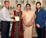 Saina Nehwal, Parupalli Kashyap invite Telangana Governor to their wedding