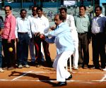 B S Satyanarayana bats during inauguration of Karnataka State Inter-Municipality Workers Tennis Ball Cricket Tournament